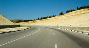 High Speed Road. Blured image speeding down a highway. speed. asphalt. sky. sunny weather Royalty Free Stock Photo