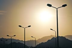 High-speed Road Highway With City Lighting Poles Lamps Stock Photos