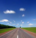 High speed on road under sky. High speed motion blur on road under blue sky Stock Photography