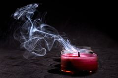 Red candle with black background stock image