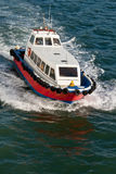 High Speed Shuttle Boat. A high speed shuttle boat, used as a lifeboat by cruise ships, underway at speed Stock Images