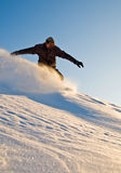 High Speed Snowboarder At Sunset Stock Photo