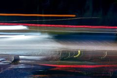 High speed traffic and blurred light trails at night Stock Image
