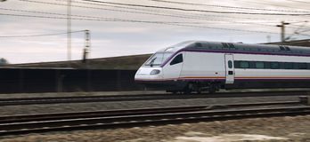 High speed train. In blurry motion near Cordoba Station in Spain Royalty Free Stock Image