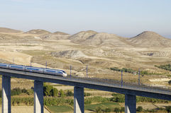 High-speed train. View of a high-speed train crossing a viaduct in Spain Royalty Free Stock Images