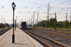 High-speed train. SLAVYANSK, UKRAINE - JUNE 26, 2012: High-speed train Donetsk-Kyiv arrives at the station Slavyansk June 26, 2012. High-speed trains in Ukraine Royalty Free Stock Photo