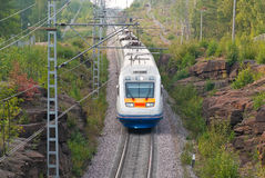 High Speed Train. Moving through the rocky place Stock Image