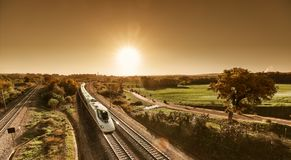 High speed train approaching from sunrise royalty free stock images