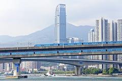 High speed train on bridge in hong kong downtown city Stock Photos