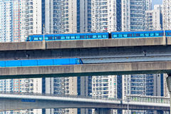 High speed train on bridge in hong kong downtown city Stock Images