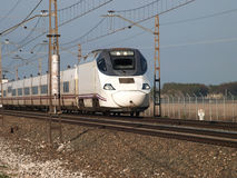 High speed train in a bright day. High speed spanish train ave crossing castilla prvince Royalty Free Stock Photography
