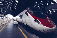 High speed train in the Central railway station in Milan - Italy.  Stock Photo