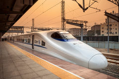 High speed train in China. A China High speed train,CRH Harmony stopped at a platform in sunset stock images
