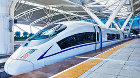 High speed train in China. Streamlined high speed bullet train arriving at railway station in China