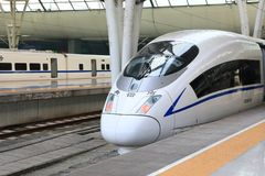 High speed train in China. Streamlined high speed bullet train arriving at Shanghai railway station in China Stock Photo