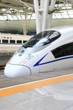 High speed train in China. Streamlined high speed bullet train arriving at Shanghai railway station in China Stock Image