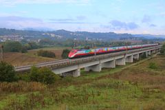 High-speed train crosses the plains of Tuscany royalty free stock photography