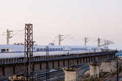 High-speed train crossing viaduct Royalty Free Stock Photos