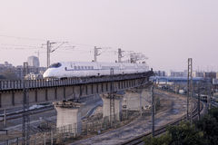 High-speed train crossing viaduct Stock Image