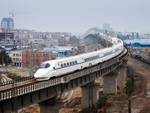 High-speed train crossing viaduct Royalty Free Stock Image