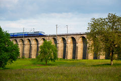 High-speed train crossing a viaduct Royalty Free Stock Photos