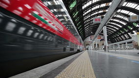High speed train departs from platform. The modern high-speed train at the station. The central railway station of Milan stock video footage