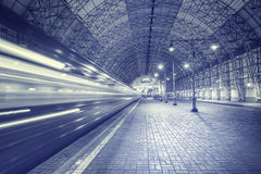 High speed train departs from the station. Royalty Free Stock Photos