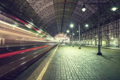 High speed train departs from the station. stock images