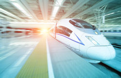 High speed train departure from station Stock Image