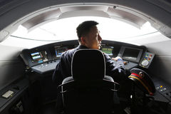 High speed train driver. Chinese high speed train driver in the cockpit royalty free stock photography