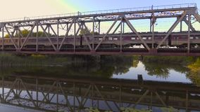 A high-speed train drives a bridge across the river stock video footage