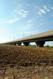 High speed train elevated railway. In farmlands Stock Photo