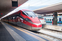 High speed train engine arriving in a train station. Railway Stock Images