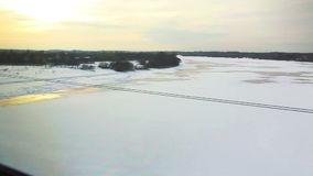High-speed train on the frozen river. HD 1080p: High angle View from the window of high-speed train on the frozen river, open spaces. The train moves on the stock footage