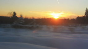 High speed train goes through snow-covered fields stock footage