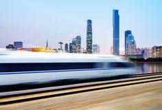 High-speed train through Guangzhou. High speed train in urban background, Guangzhou, China royalty free stock photos