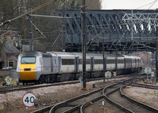 High speed train heading south from York. Class 43 diesel multiple unit or HST (high speed train) operated by East Coast leaving York railway station with a Royalty Free Stock Image