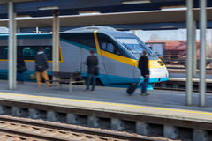High-speed train leave platform on railway station Royalty Free Stock Image