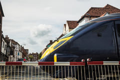 High speed train at level crossing Royalty Free Stock Photos