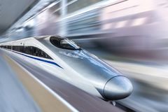 High speed train with motion blur. Streamlined high speed bullet train arriving at railway station with motion blur.Follow photography technique royalty free stock photos