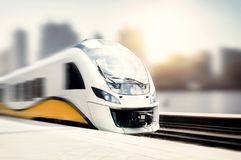 High speed train in motion at the railway station. Landscape with passenger train on railroad stock photo