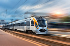 High speed train in motion at the railway station Stock Photo