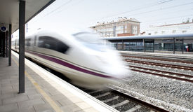 High speed train in movement on a railway station Stock Photo