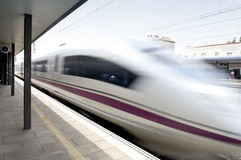 High speed train in movement on a railway station Royalty Free Stock Image