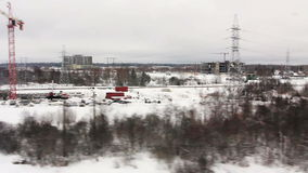 High-speed train moves past construction. HD 1080p: High-speed train moves past the projects under construction in the suburbs, Russia (POV stock video footage