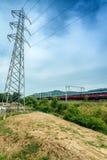 High speed train near industrial site Stock Photos