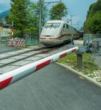high-speed train passes through the crossing. Interlaken, Switzerland stock photo