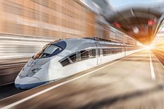 Free High Speed Train Passing Near The Passenger Station Royalty Free Stock Photos - 136702988