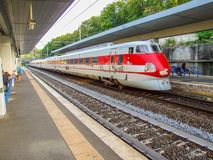 FS Class ETR 450 Pendolino at Roma San Pietro train station in Italy. High speed train passing Rome Saint Peter train terminal in Italy. Electric multiple unit royalty free stock images