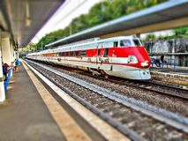 FS Class ETR 450 Pendolino at Roma San Pietro train station in Italy. High speed train passing Rome Saint Peter train terminal in Italy. Electric multiple unit royalty free stock photo